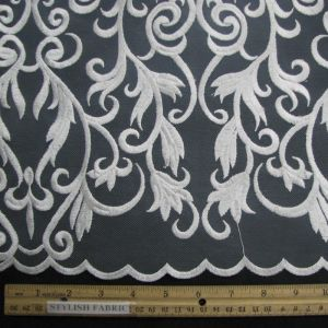 White Lace with Curling Vines Pattern and Scalloped Edge on a Mesh Fabric