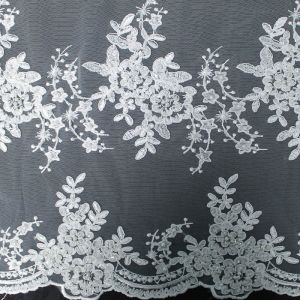 A Floral Bridal Embroidery Scalloped with Sequins on a Mesh Wedding Lace Fabric